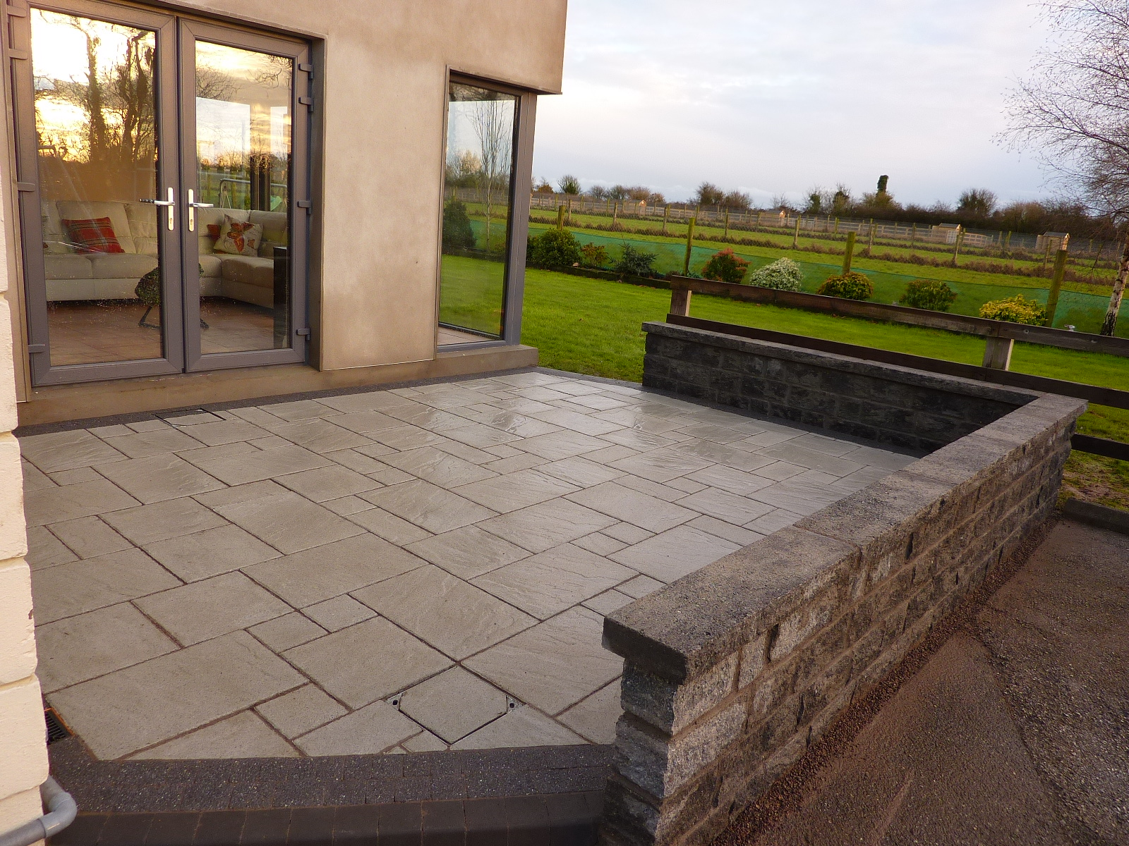 patio with low wall paving for you
